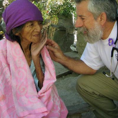 Ed Zuroweste treats elderly woman
