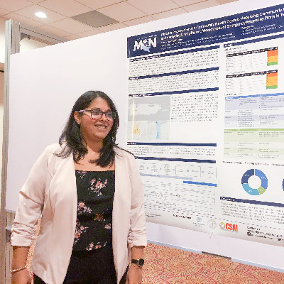 Marysel Pagan Santana poses with the poster she presented at the conference.