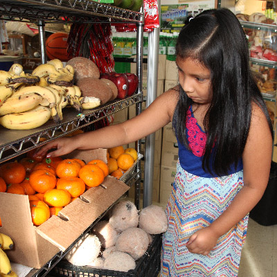 girl buying fruit