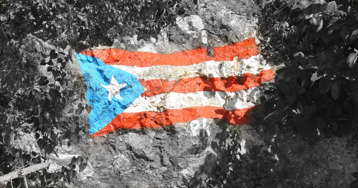 Puerto Rico flag painted on rock