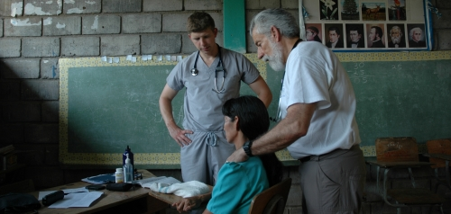 Ed Zuroweste and a medical student examine a patient