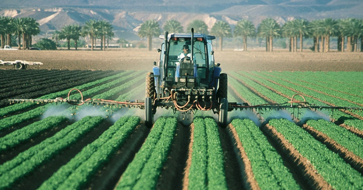 tractor-in-field-spraying-pesticides-on-crops