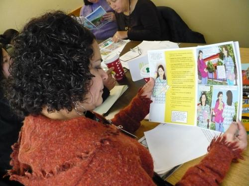 PHOTO: Mother reading lead education comic book